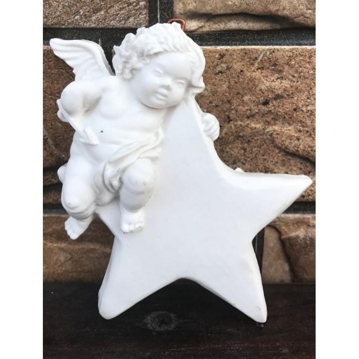 Статуэтка ангела-купидона на звезде