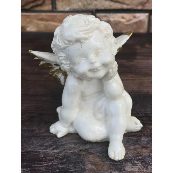 Статуэтка сидячего ангела