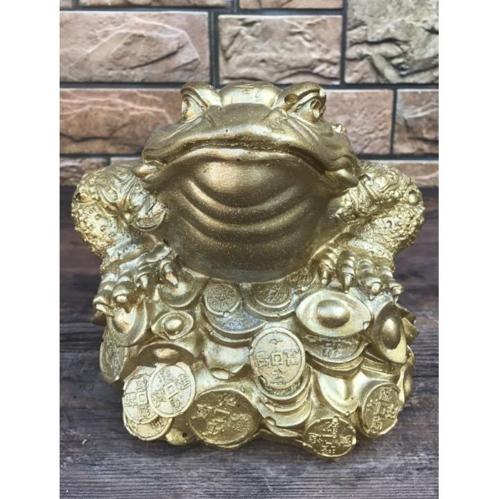 Статуэтка жабы на деньгах